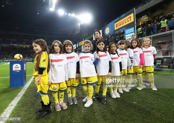 Little girls wear a shirt to support the campaign Un Rosso Alla Violenza #unrossoallaviolenza before the Serie A match between FC Internazionale and...