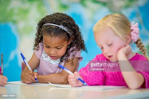Little Girls Writing Their Name