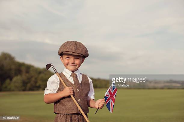 Little Golfing Boy in Vintage Attire Holding Union Jack
