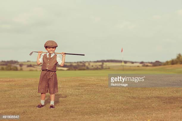 little golfing boy in vintage attire - child prodigy stock pictures, royalty-free photos & images