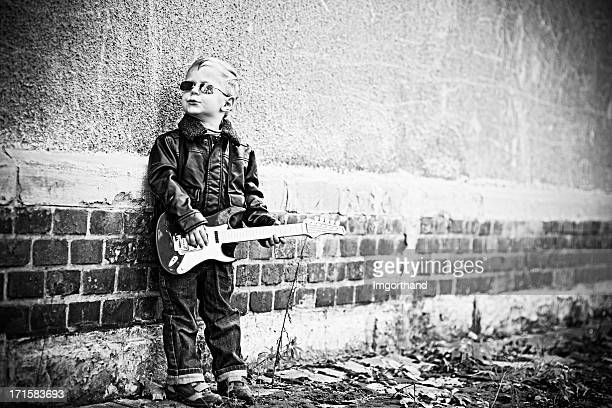 little guitar hero - guitar hero stock photos and pictures