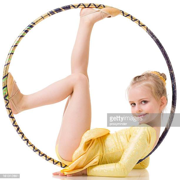 little gymnast girl with hula hoop isolated on white - little girls doing gymnastics stock photos and pictures