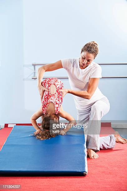 Little gymnast with coach