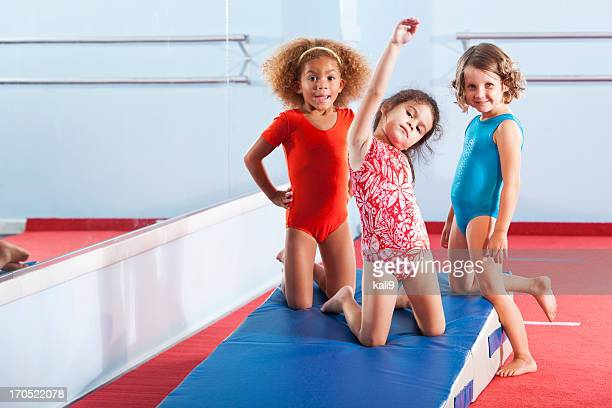 little gymnasts - little girls doing gymnastics stock photos and pictures