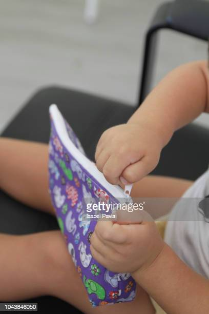 little hands opening pencil case - pencil case stock pictures, royalty-free photos & images