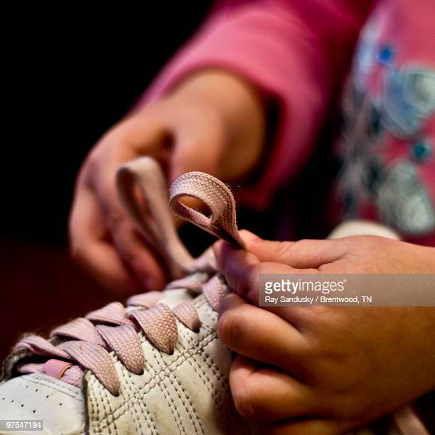 little hands - shoe tying lesson - tying shoelace stock pictures, royalty-free photos & images