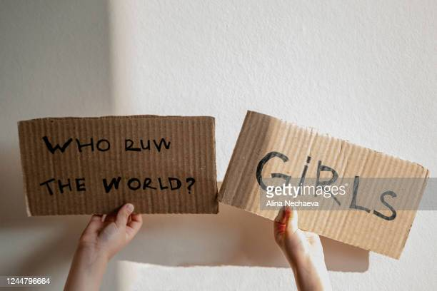 little hands with feminist sign - placard stock pictures, royalty-free photos & images