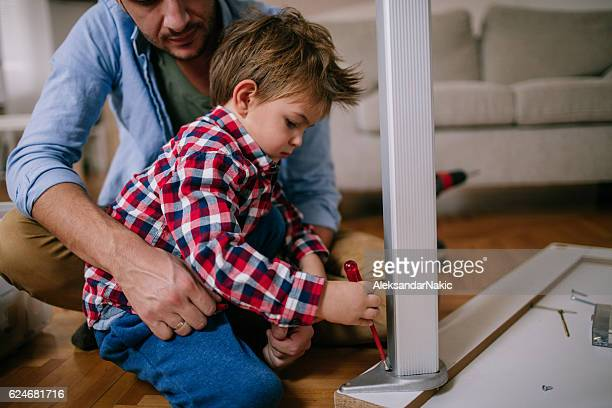 Little handyman and his father