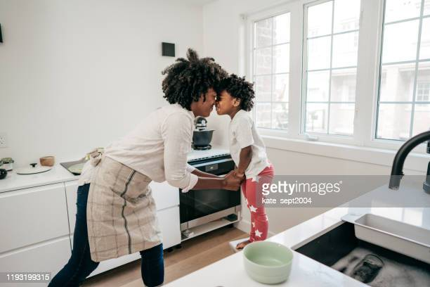 little helper in the kitchen - mental wellbeing stock pictures, royalty-free photos & images