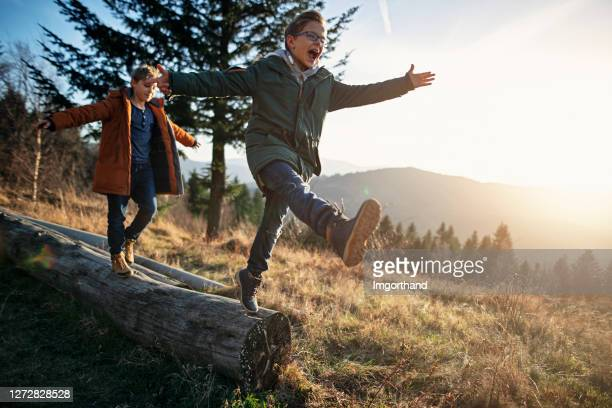 little hikers enjoying autumn nature - hill stock pictures, royalty-free photos & images