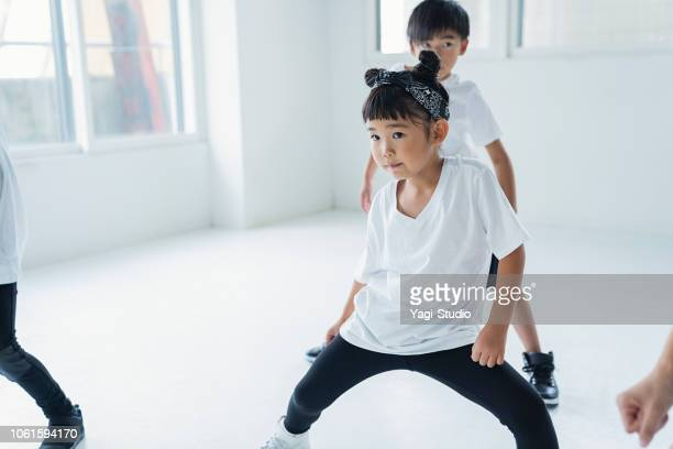 Little hiphop dancer dancing at dance studio.