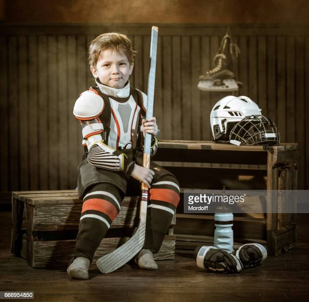 Little Hockey Player Resting After Game