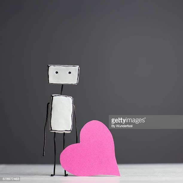 Little homemade robot with a pink heart