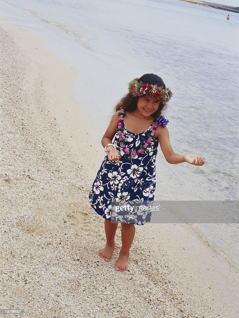Little hula girl dancing at a beach : Stock Photo