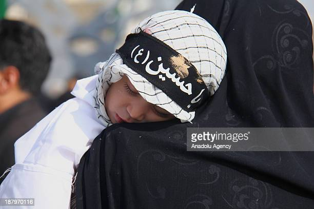 A little Iranian girl fell asleep during the mourning ceremony as part of Ashura Day at Imam Hossein Square on November 14 2013 in Tehran Iran Ashura...