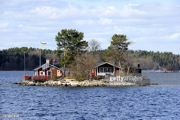 A little island with a private summer house is pictured in the archipelago of Stockholm on May 2 2010 AFP PHOTO / OLIVIER MORIN