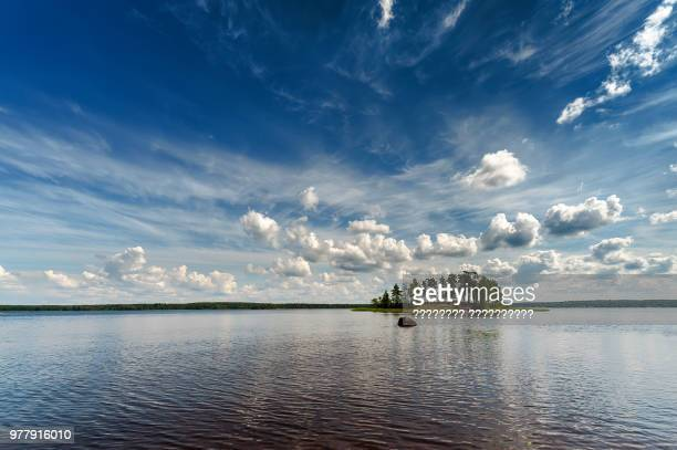 little island with trees on lake, vyborg, vyborgsky district, leningrad oblast, russia - leningrad oblast stock pictures, royalty-free photos & images