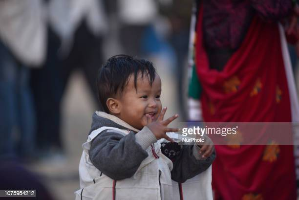 A Little kid from ethnic Gurung community dance in the tunes of traditional instruments during Tamu Lhosar or New Year celebrated in Kathmandu Nepal...