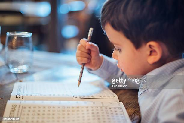 Little kid making a wordsearch