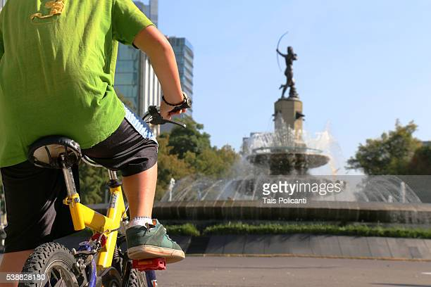 Little kid participating in a bicycle tour in Mexico City, Mexico - Diana Cazadora Fountain