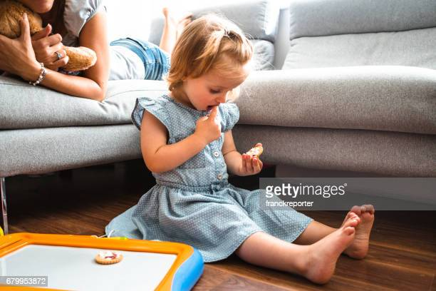 little kid playing with mom on the couch