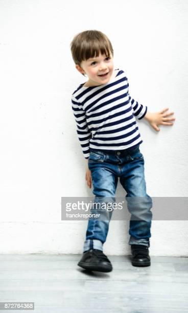 little kid portrait against a white wall
