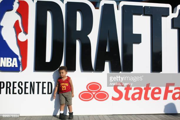 A little kid pose for a memorial photo before attending NBA Draft 2017 in Brooklyn borough of New York United States on June 22 2017