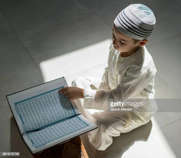 little kid reading koran - holy quran stock pictures, royalty-free photos & images