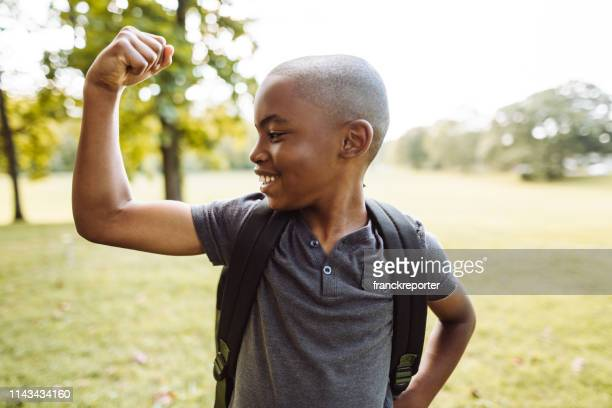 little kid showing the muscle - flexing muscles stock pictures, royalty-free photos & images