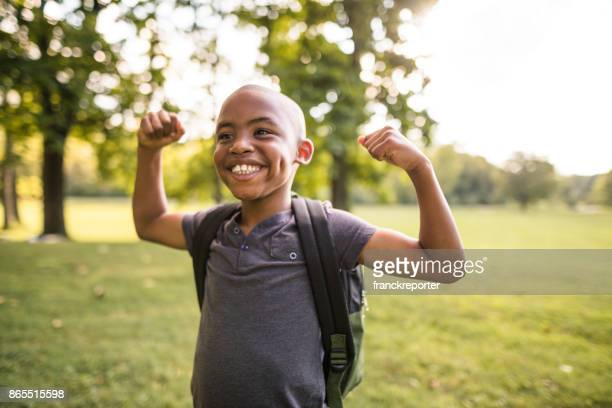little kid showing the muscle - stiff stock pictures, royalty-free photos & images