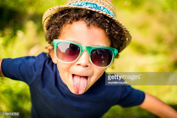 Little kid sticking out tongue