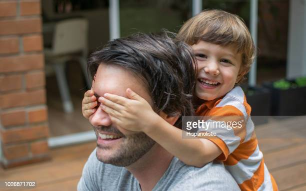 little kid surprising his dad - fathers day stock pictures, royalty-free photos & images