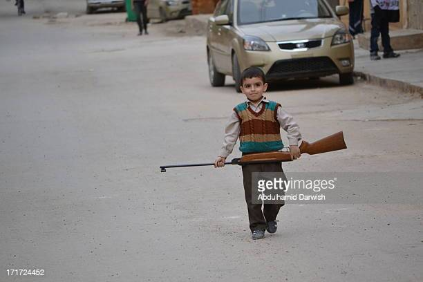 CONTENT] A little kid walking in the street in Dayr Az Zawr city east of Syria Dayr Az Zawr has been under the shelling and bombing by AlAssad regime...
