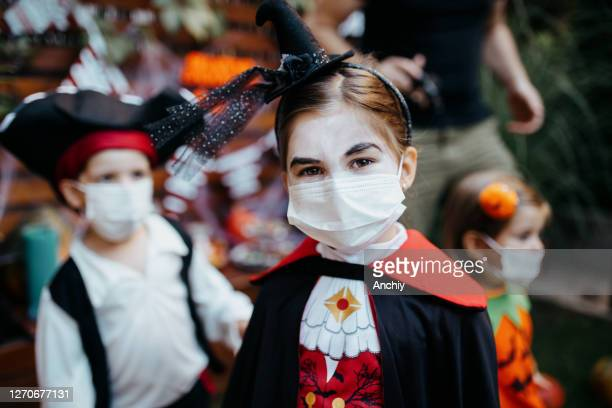 little kids at a halloween party - halloween stock pictures, royalty-free photos & images