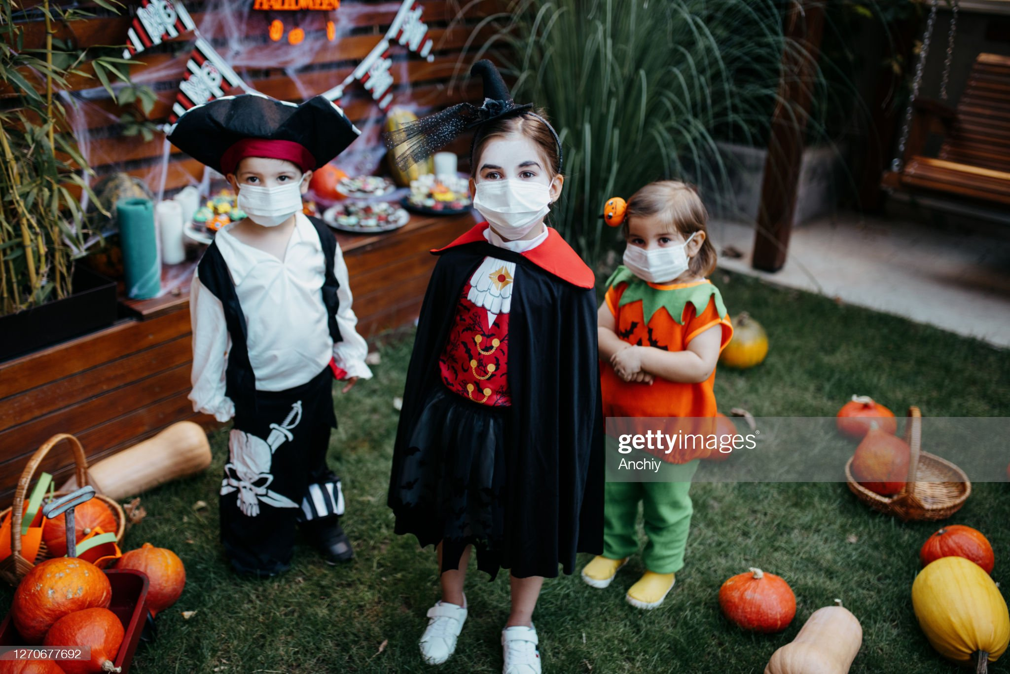 Little kids at a Halloween party : Stock Photo