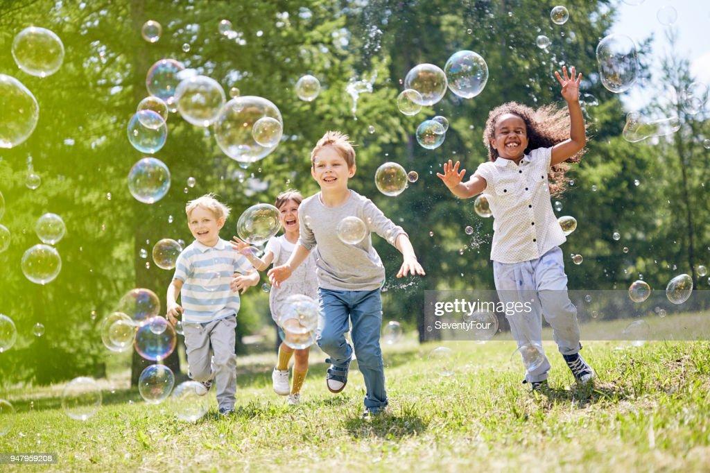 Little Kids Having Fun Outdoors : Stock Photo