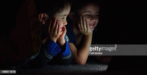 Little Kids Laughing While Watching a Screen