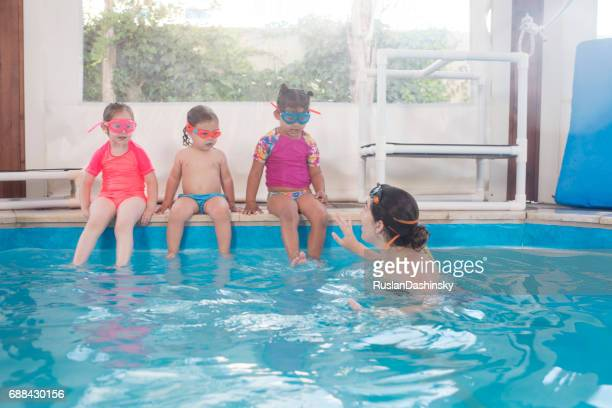 Little kids on swimming lesson.