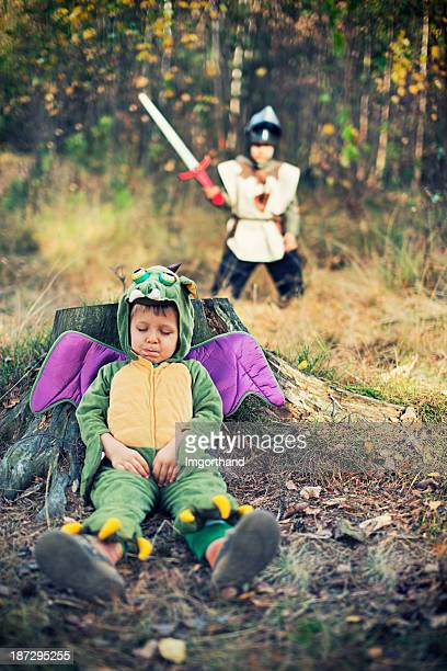 Little knight approaching the sleeping dragon