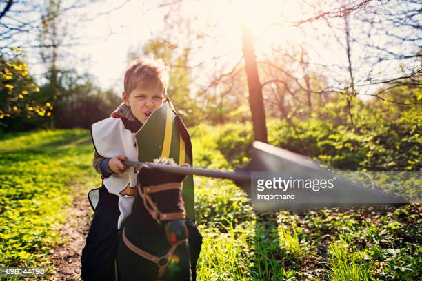 little knight charging - spear stock photos and pictures