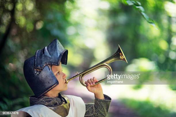 little knight playing on trumpet - bugle stock pictures, royalty-free photos & images