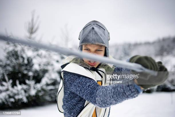 little knights fighting on a winter day - unusual angle stock pictures, royalty-free photos & images