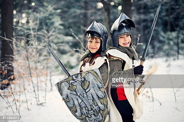 Little knights in frozen forest