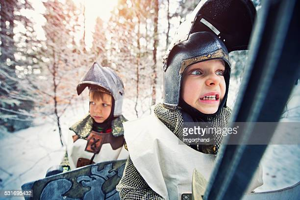 Little knights quest in frozen winter forest