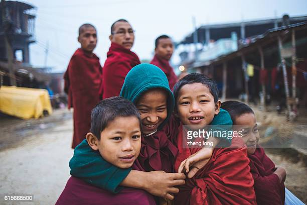 little lama look at camera in the street - lumbini nepal stock pictures, royalty-free photos & images