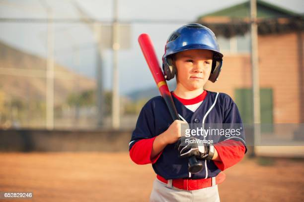 little league baseball boy is ready to bat - batting sports activity stock photos and pictures