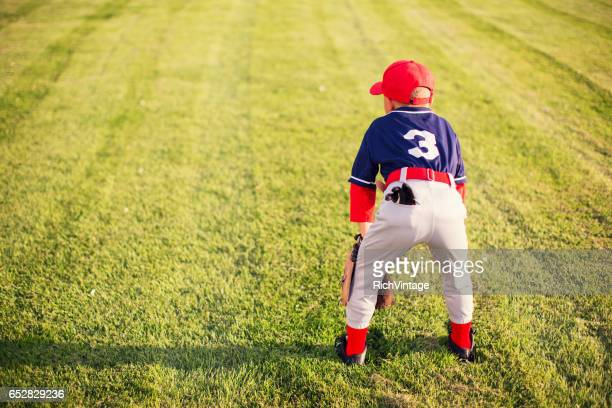 Little League Baseball Boy Plays in the Outfield