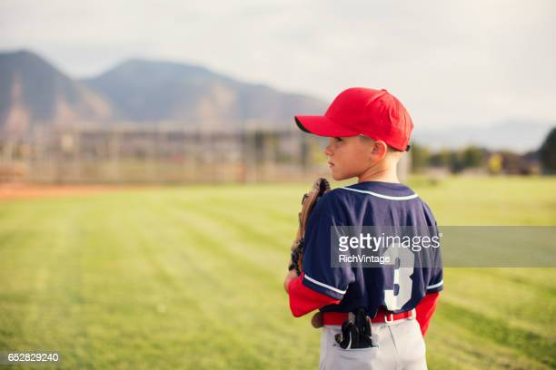 little league baseball boy profile - baseball sport stock pictures, royalty-free photos & images