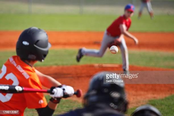 Little league baseball in midair