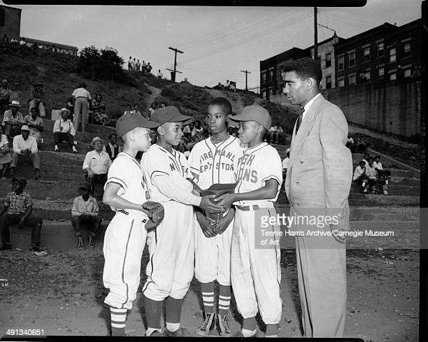 Little League baseball players from left Amvets Neal Ramsey Northside Elks Roger McCollum Fireman's Department Store Charles Franklin and Pittsburgh...